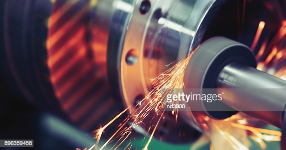 Finishing metal working on high precision grinding machine in workshop : Stock Photo