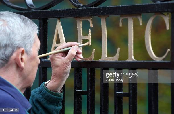 Finishing touches are made to the entrance of the All England Lawn Tennis and Croquet Club is seen ahead of the Wimbledon Lawn Tennis Championships...