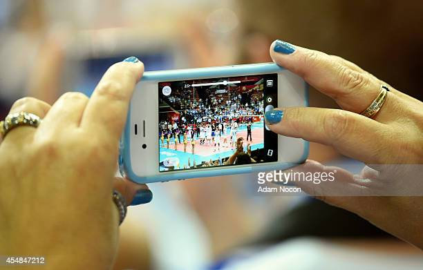 Finland fan takes pictures on a smartphone during the FIVB World Championships match between Tunisia and Finland on Septembert 7 2014 in Katowice...