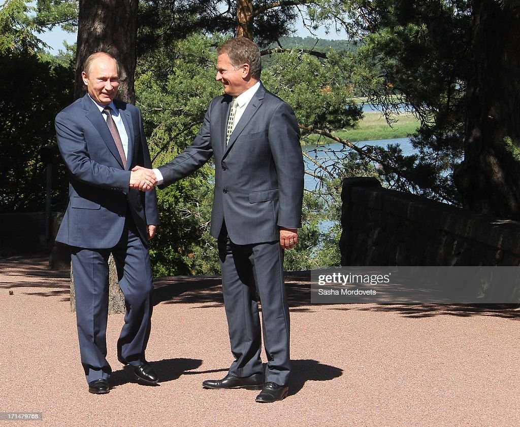 Finland President Sauli Niinisto (R) receives Russian President <a gi-track='captionPersonalityLinkClicked' href=/galleries/search?phrase=Vladimir+Putin&family=editorial&specificpeople=154896 ng-click='$event.stopPropagation()'>Vladimir Putin</a> (L) in his summer residence Kultaranta June 25, 2013 in Naantali, Finland. Putin is having a one-day visit to Finland.
