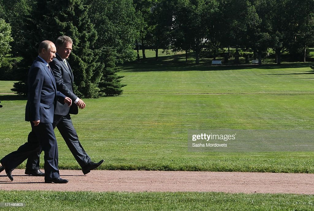 Finland President Sauli Niinisto (R) walks with Russian President <a gi-track='captionPersonalityLinkClicked' href=/galleries/search?phrase=Vladimir+Putin&family=editorial&specificpeople=154896 ng-click='$event.stopPropagation()'>Vladimir Putin</a> (L) at his summer residence Kultaranta June 25, 2013 in Naantali, Finland. Putin is having a one-day visit to Finland.
