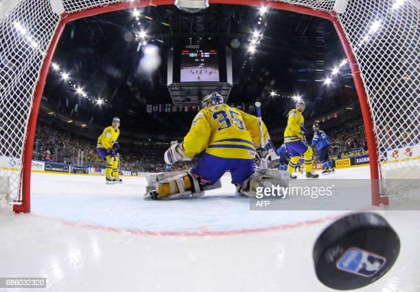 Finland scores past Sweden´s goalkeeper Henrik Lundqvist during the IIHF Men's World Championship Ice Hockey semifinal match between Sweden and...