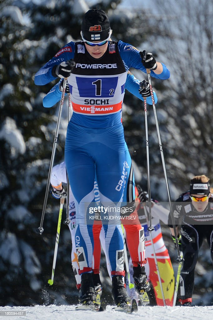 Finland's Anne Kylloenen competes during 6 x 1,25 km Ladies' Classic Team Sprint of FIS Cross Country skiing World Cup at Laura Cross Country and Biathlon Center in Russian Black Sea resort of Sochi on February 3, 2013. Finland's Mona-Lisa Malvalehto and Anne Kylloenen took the first place ahead of Russia's Julia Ivanova and Natalia Matveeva and Canada's Perianne Jones and Daria Gaiazova.