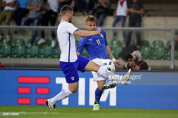 Finland's defender Joona Toivio fights for the ball with Italy's forward Cireo Immobile during the friendly football match Italy vs Finland on June 6...