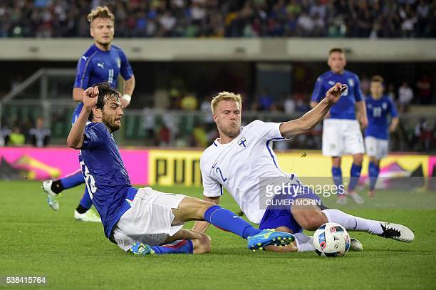 Finland's defender Paulus Arajuuri fights for the ball with Italy's midfielder Marco Parolo during the friendly football match Italy vs Finland on...