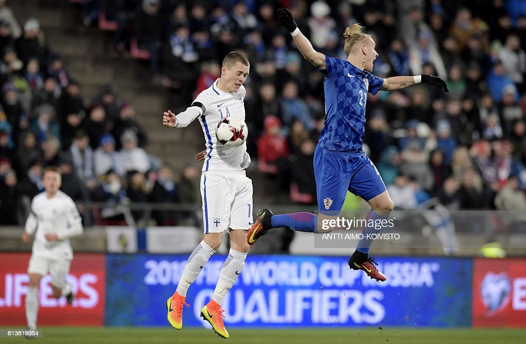 Finland's defender Thomas Lam (L) and Croatia's defender Domagoj Vida vie for the ball during the 2018 World Cup qualifier football match of Finland vs Croatia in Tampere, Finland, on October 9, 2016. / AFP / LEHTIKUVA / Antti Aimo-Koivisto / Finland OUT