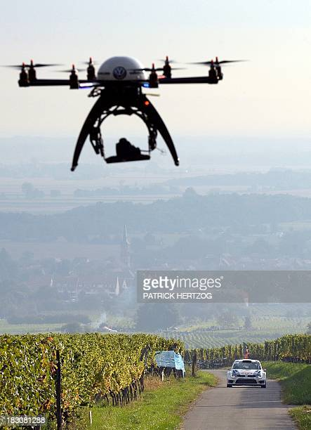Finland's driver JariMatti Latvala and codriver Miikka Anttila are pictured by a drone as they steer their Volkswagen Polo R WRC during the France's...