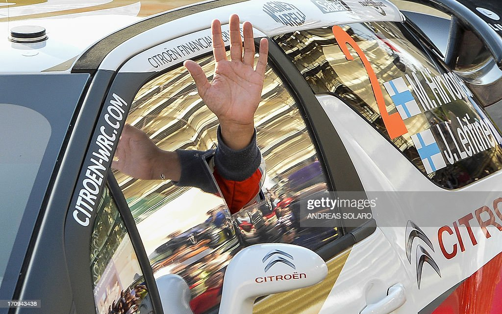 Finland's driver Mikko Hirvonen of Citroen DS3 WRC salutes his fans during the opening ceremony of the FIA World Rally Championship of Italy in Sassari, on the Italian island of Sardinia on June 20, 2013. AFP PHOTO / ANDREAS SOLARO
