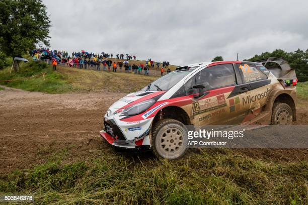 Finland's Esapekka Lappi and his codriver Janne Ferm steer their Toyota Yaris WRC during the special stage of the Orlen Rally Poland in Swietajno on...