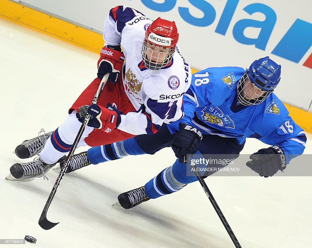 Finland's forward Aleksi Ainali (R) vies with Russia's forward Yevgeni Svechnikov during their bronze medal game of the IIHF U18 International Ice Hockey World Championship in Sochi on April 28, 2013. AFP PHOTO / ALEXANDER NEMENOV