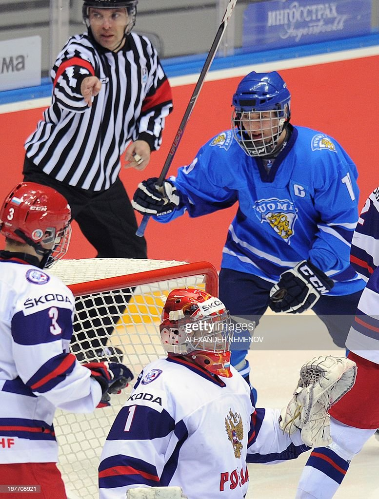 Finland's forward Alexi Mustonen celebrates after his team scored a goal against Russia's team during their bronze medal game of the IIHF U18 International Ice Hockey World Championship in Sochi on April 28, 2013.