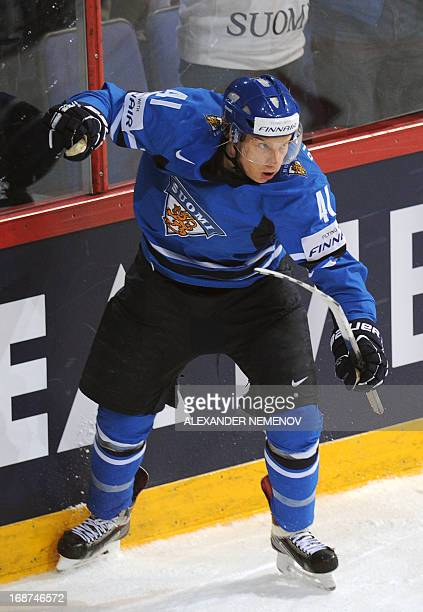 Finland's forward Antii Pihlstrom celebrates an overtime scoring during a preliminary round game Latvia vs Finland of the IIHF International Ice...