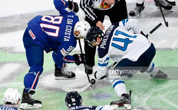 TOPSHOT Finland's forward Antti Pihlstrom vies with France's forward Teddy Da Costa during the IIHF Men World Championship group B ice hockey match...