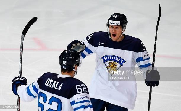 Finland's forward Jani Lajunen and team mate Forward Oskar Osala celebrates during the IIHF Ice Hockey World Championships Group B match Finland vs...