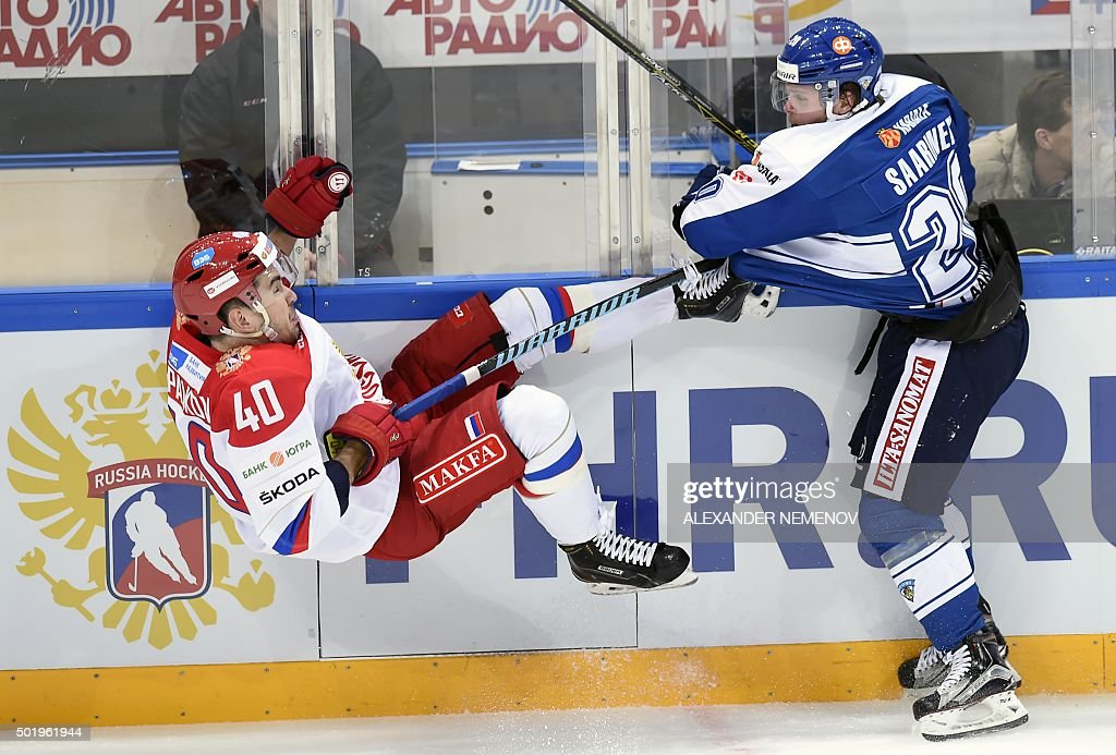 TOPSHOT Finland's forward Jesse Saarinen vies with Russia's forward Daniil Apalkov during the Channel One Cup of the Euro Hockey Tour ice hockey...