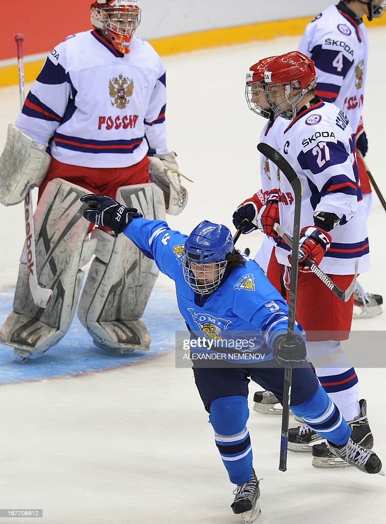 Finland's forward Jonatan Tanus celebrates after his team scored a goal against Russia's team during their bronze medal game of the IIHF U18 International Ice Hockey World Championship in Sochi on April 28, 2013. AFP PHOTO / ALEXANDER NEMENOV