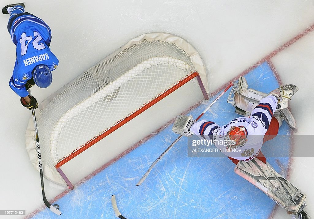 Finland's forward Kasperi Kapanen (L) attacks the net of Russia's goalie Igor Shestyorkin as Finland defeated Russia 2-1 during the bronze medal match of the IIHF U18 International Ice Hockey World Championship in Sochi on April 28, 2013.