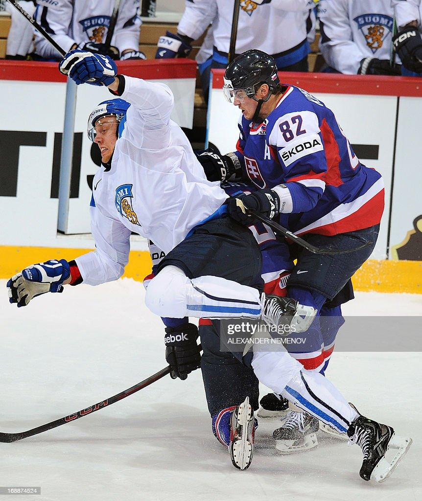 Finland's forward Marko Antilla (L) vies with Slovakia's forward Tomas Kopecky during the quarter-final match Finland vs Slovakia of the IIHF International Ice Hockey World Championship in Helsinki on May 16, 2013.