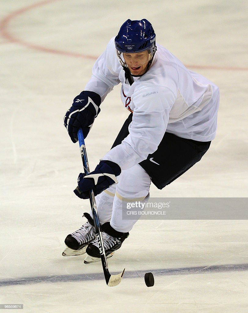 Finland's forward Niko Kapanen skates with the puck during a practice session at the Canada Hockey Place in Vancouver two days before the official opening of the XXI Vancouver Winter Olympic Games, on February 10, 2010. Finland placed second at the Torino 2006 Winter Olympics Games.