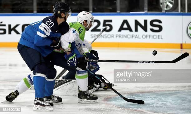 Finland's forward Sebastian Aho vies with Slovenian defender Bla Gregorc during the IIHF Men's World Championship Finland vs Slovenia group B ice...