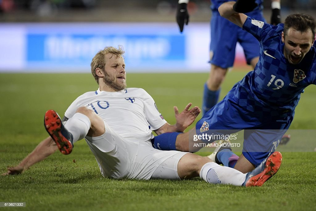 Finland's forward Teemu Pukki (L) and Croatia's midfielder Milan Badelj fall on the pitch during the 2018 World Cup qualifier football match of Finland vs Croatia in Tampere, Finland, on October 9, 2016. / AFP / LEHTIKUVA / Antti Aimo-Koivisto / Finland OUT