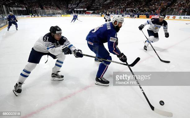 Finland's forward Valterri Filppula and France's defender Antonin Manavian fight for the puck during the IIHF Men's World Championship group B match...