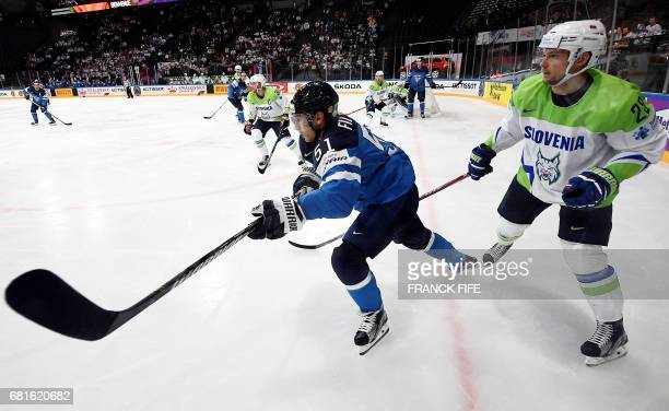 Finland's forward Valterri Filppula and Slovenian defender Ales Kranjc fight for the puck during the IIHF Men's World Championship Finland vs...