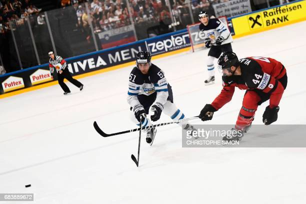 Finland's forward Valtteri Filppula vies with Canada's defender MarcEdouard Vlasic during the IIHF Men's World Championship group B ice hockey match...