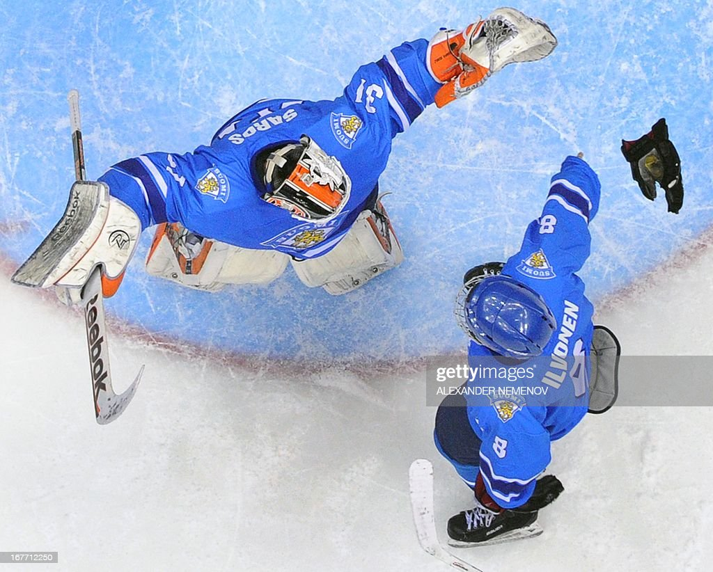 Finland's goalie Juuse Saros (L) and defender Mika Ilvonen celebrate after they defeated Russia in a IIHF U18 International Ice Hockey World Championship bronze medal match in Sochi on April 28, 2013. AFP PHOTO / ALEXANDER NEMENOV