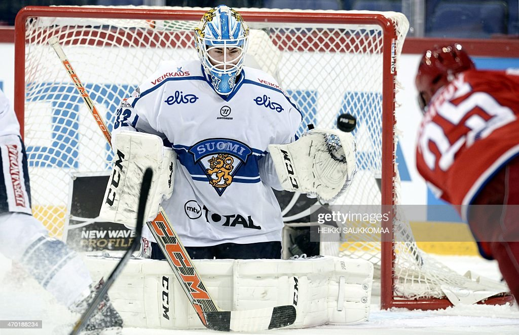 Finland's goalie Juuse Saros makes a save during the Ice Hockey Euro Hockey Tour match Finland vs Russia in Helsinki Finland on April 18 2015 AFP...