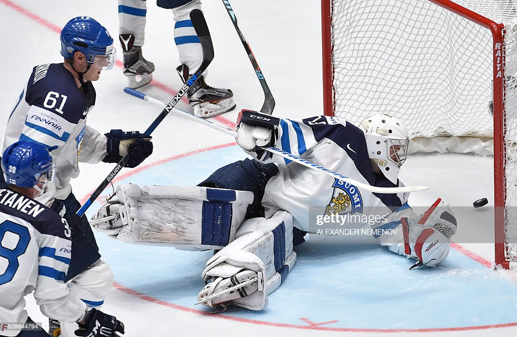 Finland's goalie Mikko Koskinen eyes the puck in his netduring the group B preliminary round game Finland vs Belarus at the 2016 IIHF Ice Hockey World Championship in St. Petersburg on May 6, 2016. / AFP / ALEXANDER