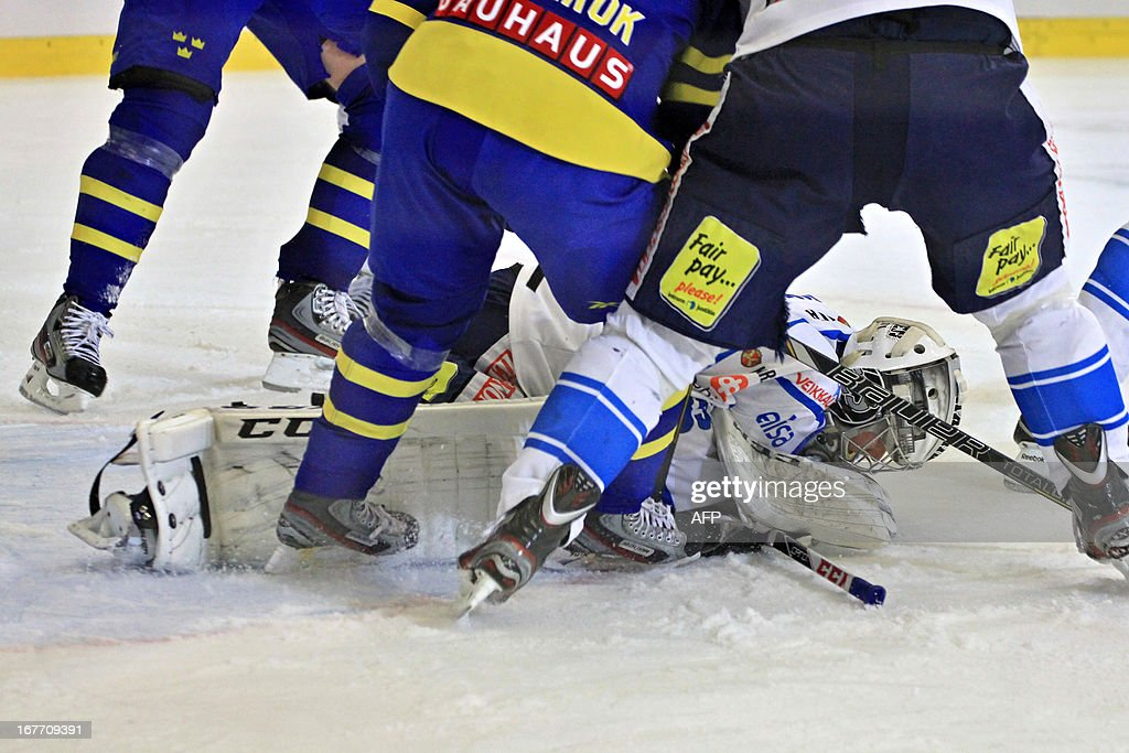 Finland's goalkeeper Atte Engren lies on the ice during the ice hockey match Sweden-Finland at the Czech hockey games, the last of the four Euro Hockey Tour tournaments, on April 28, 2013 in Brno, Czech Republic.