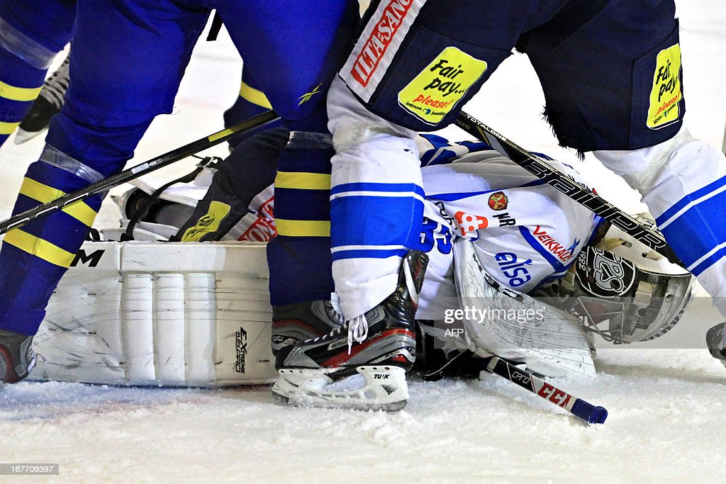 Finland's goalkeeper Atte Engren lies on the ice during the ice hockey match Sweden-Finland at the Czech hockey games, the last of the four Euro Hockey Tour tournaments, on April 28, 2013 in Brno, Czech Republic. AFP PHOTO / RADEK MICA