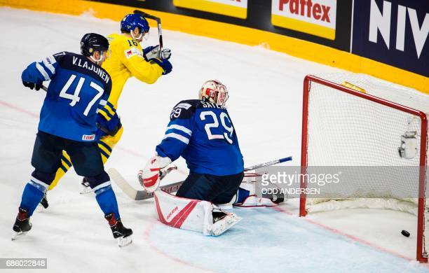 Finland´s goalkeeper Harri Sateri watches the puck in goal as Sweden scored their fourth goal during the IIHF Men's World Championship Ice Hockey...