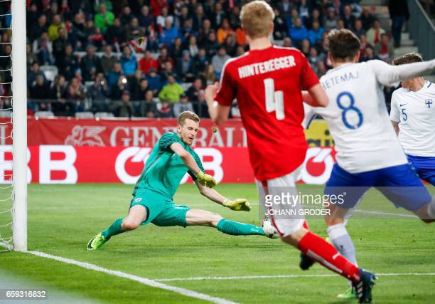 Finland's goalkeeper Lukas Hradecky makes a save during the friendly football match between Austria and Finland in Innsbruck on March 28 2017 / AFP...