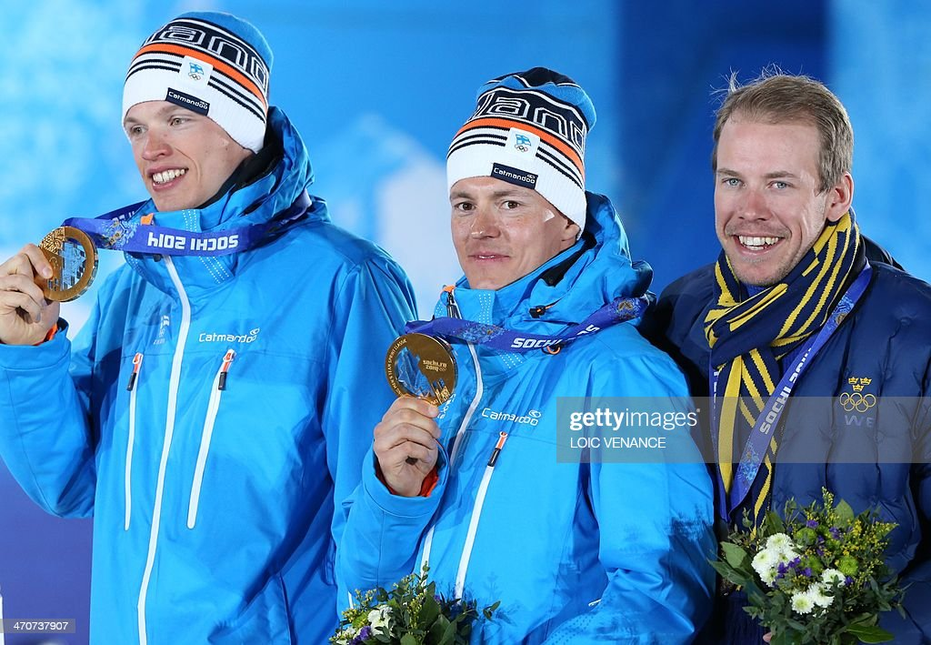 Finland's gold medalists Iivo Niskanen and Sami Jauhojaervi and Sweden's bronze medalist Emil Joensson pose during the Men's CrossCountry Skiing Team...