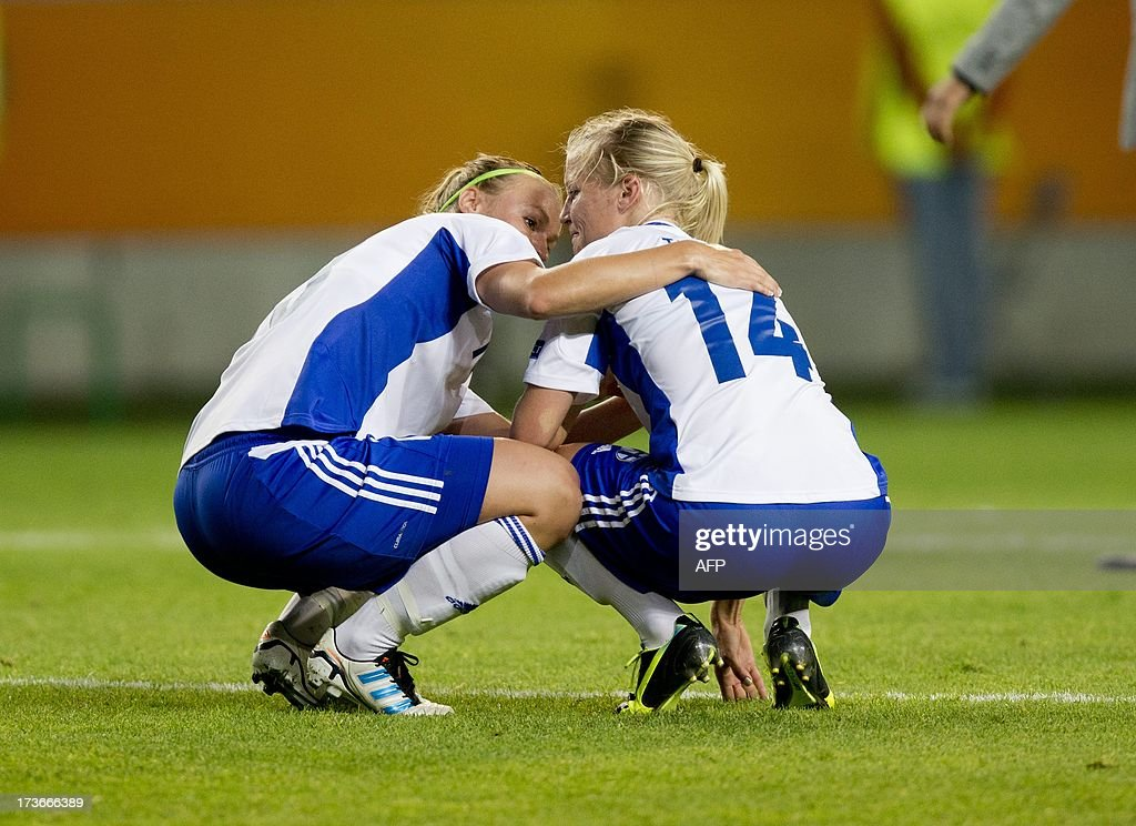 Finland's Heidi Kivela and Sanna Talonen react after the UEFA Women's EURO 2013 group A soccer match between Denmark and Finland, at Gamla Ullevi stadium in Gothenburg, Sweden, on July 16, 2013.