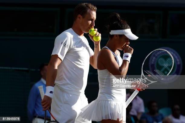 Finland's Henri Kontinen and Britain's Heather Watson talk between points against India's Rohan Bopanna and Canada's Gabriela Dabrowski during their...