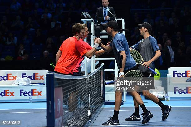 Finland's Henri Kontinen and his partner Australia's John Peers shake hands at the net after beating US player Bob Bryan and US player Mike Bryan...