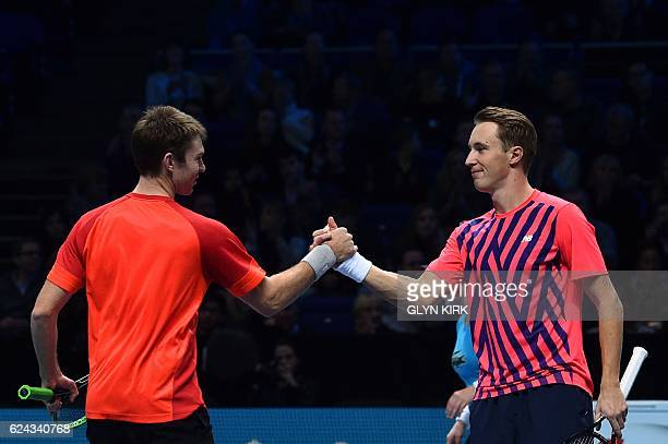 Finland's Henri Kontinen and his partner Australia's John Peers celebrate beating US player Bob Bryan and US player Mike Bryan during their men's...