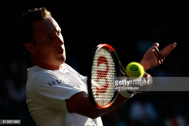 Finland's Henri Kontinen plays with his partner Britain's Heather Watson against India's Rohan Bopanna and Canada's Gabriela Dabrowski during their...