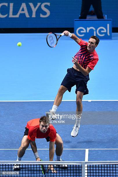 Finland's Henri Kontinen returns over the head of his partner Australia's John Peers against US player Bob Bryan and US player Mike Bryan during...