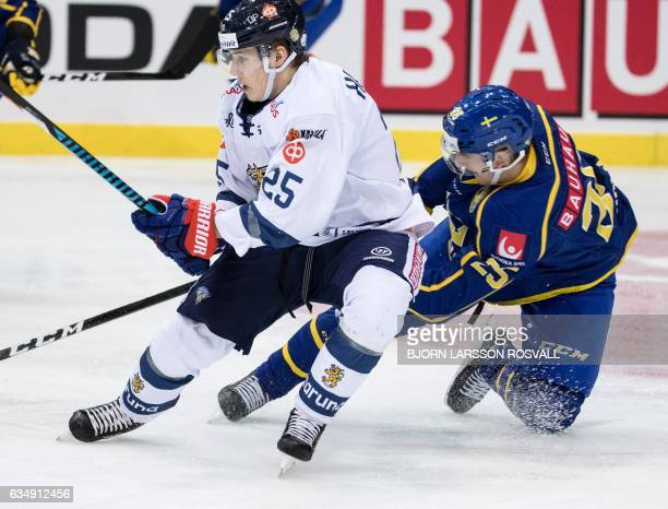 Finland's Henrik Haapala and Sweden Calle Rosen vie during the Sweden Hockey Games match Sweden vs Finland at the Scandinavium Arena in Goteborg...