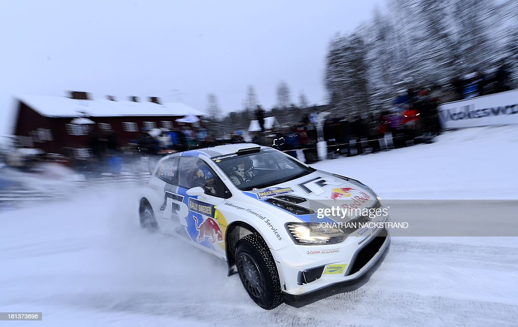 Finland's Jari-Matti Latvala and his co-driver Mikka Anttila steer their Volkswagen Polo R WRC during Mitandersfors stage, the 17th of Rally Sweden, second round of the FIA World Rally Championship on February 10, 2013 in Kirkenaer, Norway.
