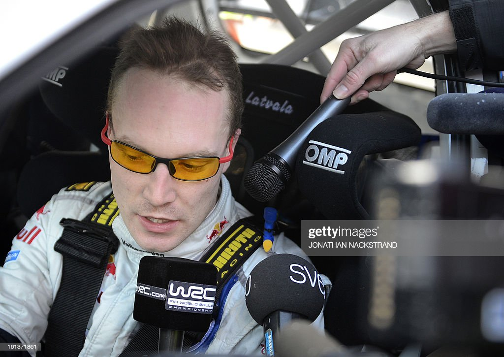 Finland's Jari-Matti Latvala answers to journalists after crossing the finish line of the 22nd and the last stage of Rally Sweden, FIA World Rally Championship second round in Karlstad, Sweden on February 10, 2013. AFP PHOTO/JONATHAN NACKSTRAND