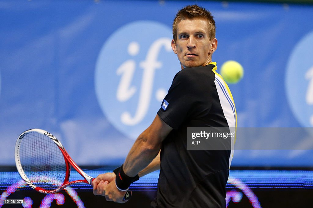 Finland's Jarkko Nieminen returns the ball to Australia's Lleyton Hewitt during their match in the Stockholm Open at Kungliga Tennishallen in Stockholm, Sweden on October 17, 2012. AFP PHOTO / SCANPIX SWEDEN / SOREN ANDERSSON SWEDEN OUT