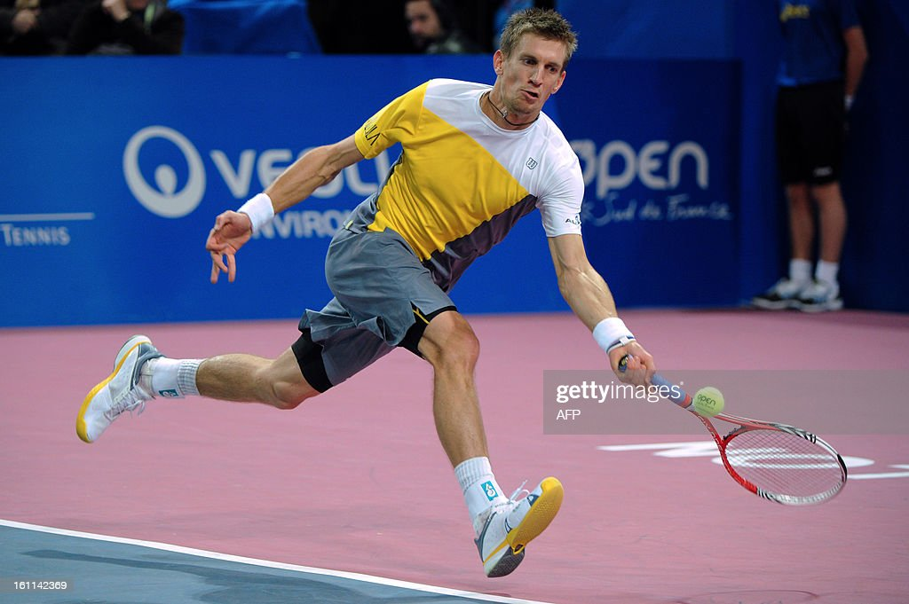 Finland's Jarkko Nieminen returns the ball to his French opponent Richard Gasquet during the Open Sud de France world tour ATP Series semi final tennis match, on February 9, 2013 in Montpellier southern France. Gasquet won the match. AFP PHOTO / SYLVAIN THOMAS