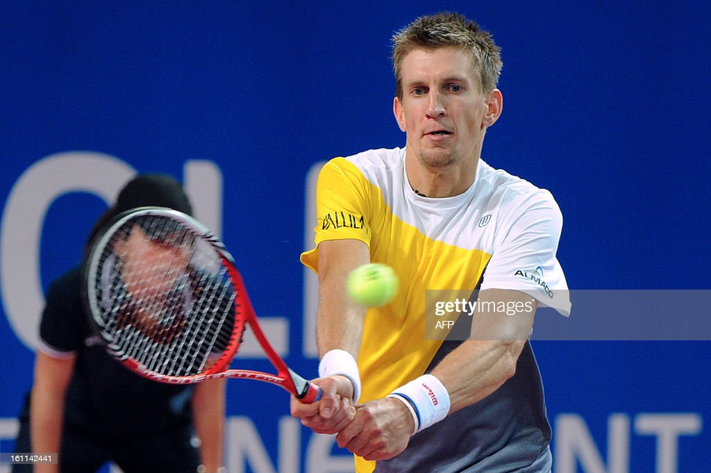 Finland's Jarkko Nieminen returns the ball to his French opponent Richard Gasquet during the Open Sud de France world tour ATP Series semi final tennis match, on February 9, 2013 in Montpellier southern France. Gasquet won the match.