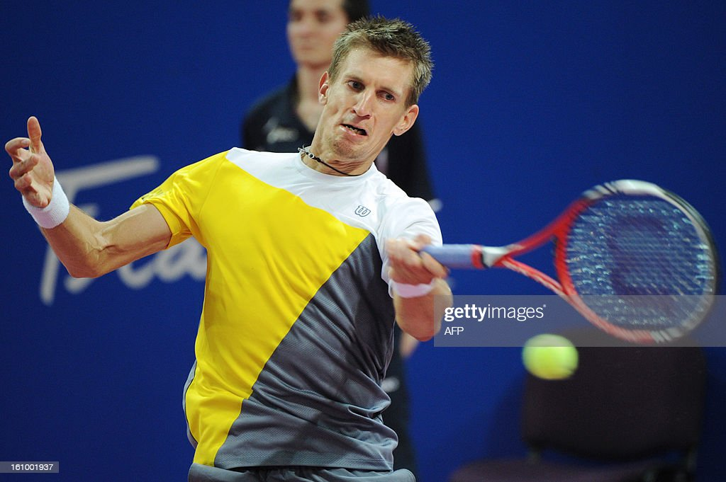 Finland's Jarkko Nieminen returns the ball to his opponent Sergiy Stakhovsky of Ukraine during the Open Sud de France world tour ATP Series quarter final tennis match on February 8, 2013 in Montpellier southern France. Nieminen won the match.