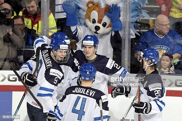 Finland's Jesse Puljujarvi goal scorer Patrik Laine Olli Juolevi Julius Nättinen and Sebastian Aho celebrate game winning goal 54 during the 2016...